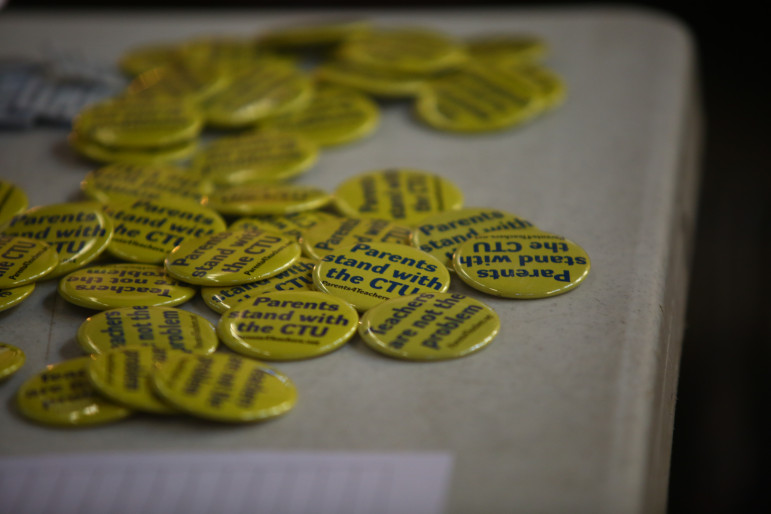 Buttons for sale at a CTU community contract forum on the North Side sponsored by Parents 4 Teachers at Luther Memorial Lutheran Church on May 19, 2015.