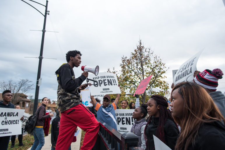 Amandla Charter School student D'Antione Bland performs at a rally in Englewood on Nov. 11, 2015 to save his school after CPS recommended it close for poor performance.