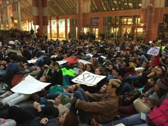CPS students lie on the ground outside the Thompson Center at the Nov. 6 citywide rally to show a unified group against budget cuts.