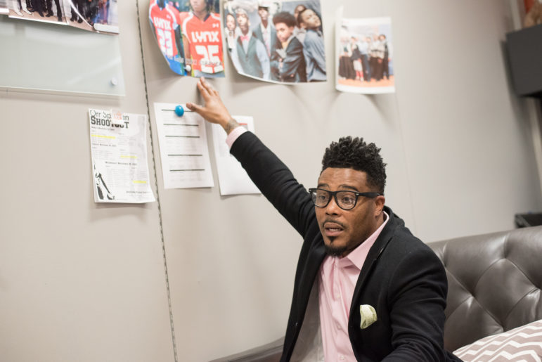 "Principal Christopher Goins points to a photo of two Butler students who died in separate shootings last school year. It was the first time he'd ever lost students to gun violence and he struggled to help students and teachers cope with the losses. ""I just asked for God to guide me. And I had to just go with my intuitions and what I felt people needed."""