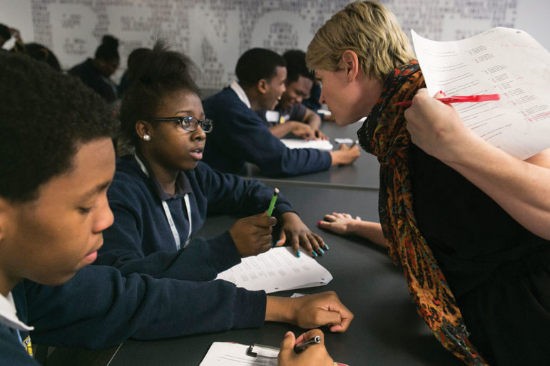 "In mid-November at Baker College Prep, English teacher Jennifer Wright co-teaches a lesson to 9th- and 10-graders practicing ""comma rules and sentence patterns in ACT style passages."" After reviewing questions on paper, students divide into two teams. Using handheld clickers, they vote for the correct answers, vying for a no-homework prize."