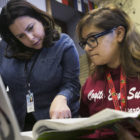 Spanish teacher Elga Maritza Castillo helps a Kelly High School student in February. Generation All awarded the Brighton Park Neighborhood Council $50,000 to connect and support three Southwest Side neighborhood high schools, including Kelly.