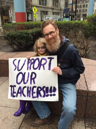 Tim Lacey and his 8-year-old daughter, Lily, just after the student rally.