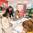 Staff at Peck Elementary's child-parent center offer English classes for students' parents, many of whom are immigrants from Mexico. Here, parent Nereida Dejesus works on reading activities with teachers Lucina Sosa and Leticia Alvarez.