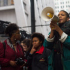 In October 2015, students led protests against budget cuts in CPS. At the megaphone is Stella Binon, who called for more state funding for schools.