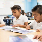 Hurley Elementary student Lex Posada and his classmates work on reading and pronunciation in Spanish with kindergarten bilingual teacher Yesenia Hinojosa. The school is one of five that's adding a dual language program.