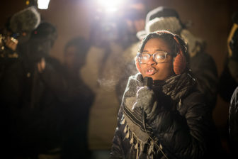 """We're here for the families,"" Charlene Carruthers, national director of Black Youth Project 100, said at a rally for police shooting victim Ronald Johnson outside a Chicago police station at 51st Street and Wentworth Avenue on December 7, 2015."