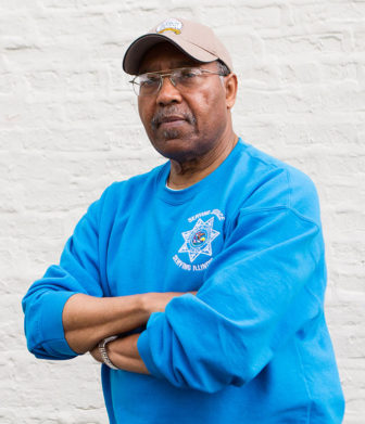 Percy Coleman, the father of Philip Coleman, works as a parole officer with the Illinois Department of Corrections in the Woodlawn neighborhood.