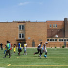 Boys from the nonprofit group Kidz Express play soccer on the field of George Leland Elementary School, a West Side public school. A few blocks away, the former Leland building was shuttered in 2013 and has been purchased as a new home for the group.