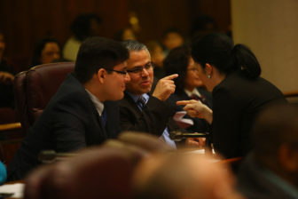 Ald. Gilbert Villegas (center) attends a Chicago City Council meeting on May 20, 2015, his first after being elected.