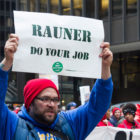 A demonstrator displays a sign at a march organized by the Chicago Teachers Union during their one-day strike on April 1, 2016.