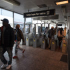 Commuters enter and exit the 95/Dan Ryan station, which is the last stop of the Red Line.