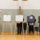 Voters fill out primary ballots at Shoesmith Elementary School in the Kenwood/Hyde Park neighborhood on March 15, 2016, the first election in Illinois where same-day registration was allowed.