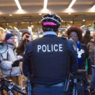 A crowd protesting the handling of the Laquan McDonald case confronts police outside of the Hyatt Regency McCormick Place during Mayor Rahm Emanuel's MLK breakfast on Jan. 15, 2016.