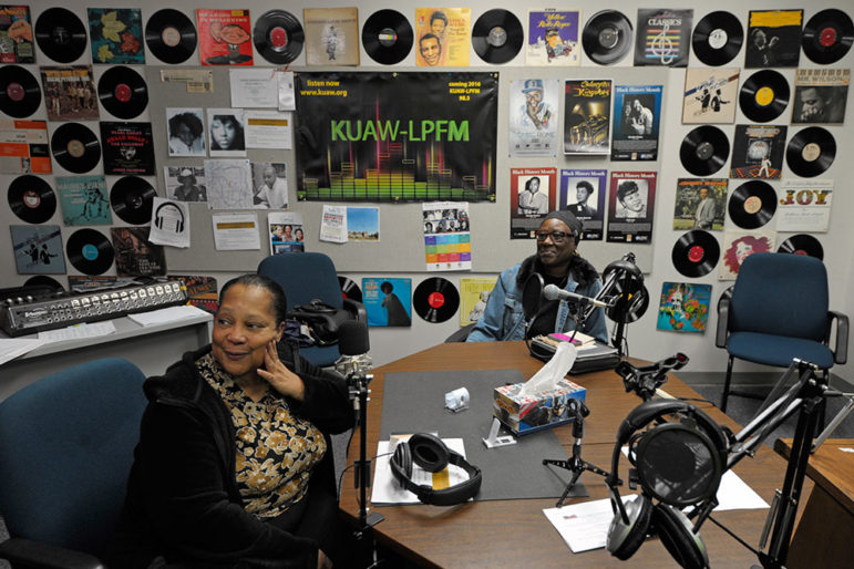 Camilla Cochran (left) and Mildred Walker host a community radio program that broadcasts from the second floor of a Kansas City closed school that was purchased by the W.E.B. DuBois Learning Center.