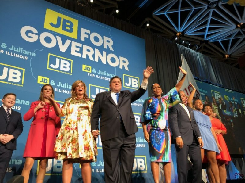 Governor- and Lieutenant Governor-elect J.B. Pritzker and Juliana Stratton greet supporters with their families after election results handed the Democratic team a decisive win Nov. 6.