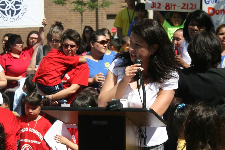 Rebecca Estrada, executive director of El Hogar del Nino, speaks against child care funding cuts at a press conference Thursday.