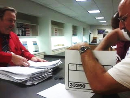 Organizers hand petitions for a referendum on an elected School Board to a staff member at the Chicago Board of Elections.